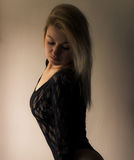 Blonde in lace. Blond woman in black lace royalty free stock photos