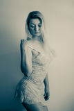 Blonde in lace. Blond woman wearing lace nightgown stock images