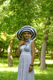 Blonde lady with big summer hat Royalty Free Stock Images