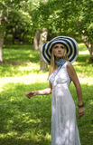 Blonde lady with big summer hat Stock Image