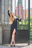 Blonde lady in black dress with decolletage Stock Image