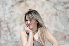 Blonde lady do a grimace Stock Photos