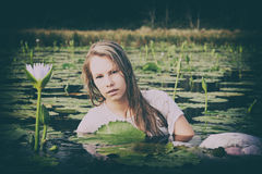 Blonde lady floating amongst the lillies Stock Photos