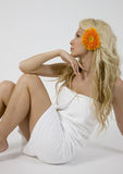 Blonde lady with gerbera Royalty Free Stock Images