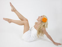 Blonde lady with gerbera Royalty Free Stock Photo