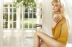 Blonde lady in the luxury house Royalty Free Stock Images