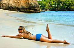 Blonde lady lying in water on the beach Stock Photography