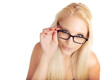 Blonde Lady Pouting While Holding Her Glasses' Frame Royalty Free Stock Photos
