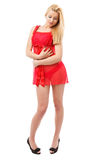 Blonde lady in red negligee Royalty Free Stock Images