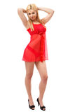 Blonde lady in red negligee Stock Photography