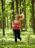 Blonde lady running Stock Photo