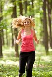 Blonde lady running Stock Photos