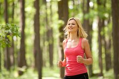 Blonde lady running Royalty Free Stock Photo