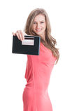 Blonde lady showing a tablet and credit card Royalty Free Stock Images
