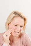 Blonde Lady with Toothache in Pain with Copy Space Royalty Free Stock Photos
