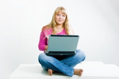 Blonde with a laptop Stock Photography