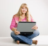 Blonde with a laptop Royalty Free Stock Image