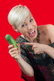 Blonde laughing and holding cucumber Stock Photos