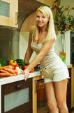Blonde leaned on kitchen table Royalty Free Stock Photos