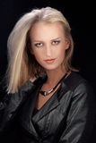 Blonde in leather jacket Royalty Free Stock Image