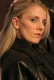 Blonde in Leather two Royalty Free Stock Photos