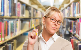 Blonde Librarian, Student or Teacher with Pencil in Library. Stock Image