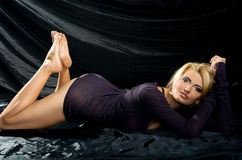 Blonde lies  black satin fabrics Stock Images