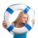 Blonde with lifsaver Stock Image