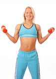 Blonde lifting weights Royalty Free Stock Images