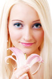 Blonde with lily Stock Images