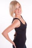 Blonde lindo en negro Foto de archivo libre de regalías