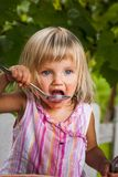 Blonde litle girl eats a slice of watermelon Stock Images