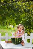 Blonde litle girl eats a slice of watermelon Royalty Free Stock Photography