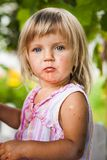 Blonde litle girl eats a slice of watermelon Royalty Free Stock Image