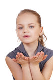 Blonde little Girl Blowing a Kiss, isolated on white background Stock Image