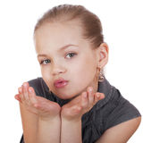Blonde little Girl Blowing a Kiss, isolated on white background Royalty Free Stock Photography