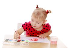 Blonde little girl draws paints table now Stock Photo