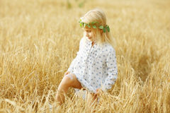 Blonde little girl in the field Royalty Free Stock Images