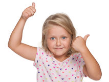 Blonde little girl holds her thumbs up Royalty Free Stock Image