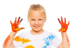 Blonde little girl shows painted palms Stock Images