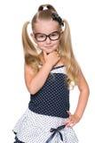 Blonde little girl thinks Stock Photo