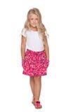 Blonde little girl walks Royalty Free Stock Photo