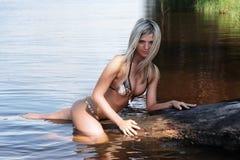 Blonde on log Royalty Free Stock Photos