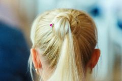 The blonde hair girls. Rear view. A bump from long hair girls royalty free stock images