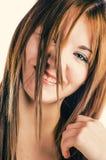 Blonde looking through her hair Stock Photo