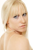 Blonde looking over shoulder Royalty Free Stock Images