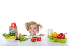 Blonde looks for fresh vegetables. Royalty Free Stock Images