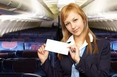 Blonde luchtstewardess (stewardess) stock foto's