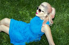 blonde lying on the grass royalty free stock photo