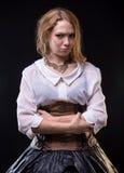Blonde mürrische Frau im Fantasiekleid Lizenzfreie Stockbilder